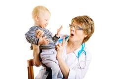 Criança e doutor Imagem de Stock