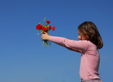 Criança e flores Imagem de Stock