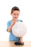Criança e globo imagem de stock