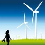 Criança e moinhos de vento Fotos de Stock Royalty Free