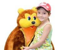 A criança e o brinquedo Fotografia de Stock Royalty Free