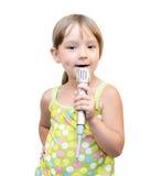 A criança e o microfone Fotografia de Stock Royalty Free
