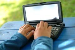 Criança e PDA Fotografia de Stock