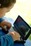 Criança e PDA Imagem de Stock Royalty Free