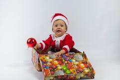 Criança e presente Imagens de Stock Royalty Free