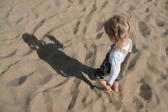 Criança e sombra Fotografia de Stock