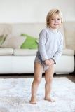 Criança em casa Imagem de Stock Royalty Free
