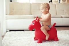 Criança em casa Fotos de Stock Royalty Free
