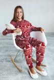 Criança em pijamas do inverno Fotos de Stock