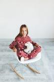 Criança em pijamas do inverno Imagens de Stock