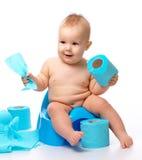 Criança em potty fotos de stock