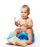 Criança em potty fotografia de stock royalty free