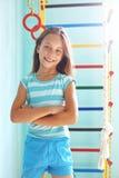 Criança em um campo de jogos Foto de Stock Royalty Free