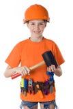 A criança em um capacete Fotos de Stock Royalty Free