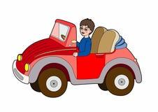 Criança em um carro vermelho Foto de Stock Royalty Free