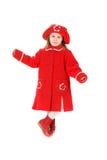 Criança em um revestimento vermelho Imagem de Stock