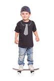 Criança em um skate Foto de Stock Royalty Free