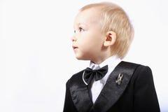 Criança em um smoking fotos de stock