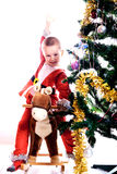 A criança em um terno do gnomo do Natal imagem de stock royalty free