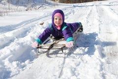 Criança em um trenó Fotografia de Stock Royalty Free