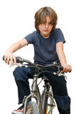 Criança em uma bicicleta Fotos de Stock Royalty Free