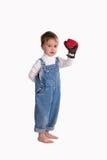 A criança em uma luva de encaixotamento Imagens de Stock
