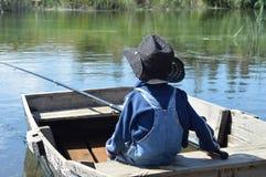 Criança em uma viagem de pesca Imagens de Stock Royalty Free