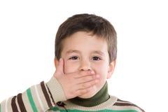 Criança engraçada que cobre sua boca Fotos de Stock Royalty Free