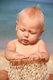 Criança engraçada que rufa na praia Fotografia de Stock Royalty Free
