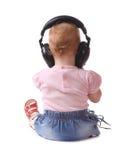 A criança escuta a música imagens de stock royalty free