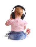 A criança escuta a música Fotos de Stock Royalty Free