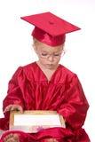 Criança esperta com livro Foto de Stock Royalty Free