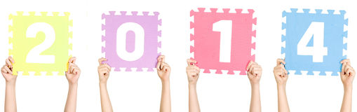 A criança está guardando 2014, conceito do ano novo Imagem de Stock Royalty Free