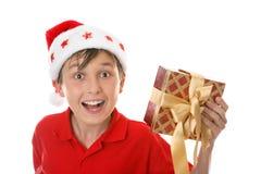 Criança exuberante com presente do Natal foto de stock royalty free