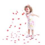 Criança fêmea doce com rosas Foto de Stock Royalty Free