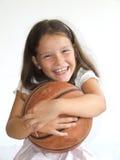 Criança feliz com basquetebol Fotografia de Stock Royalty Free