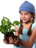 Criança feliz com planta Imagens de Stock Royalty Free