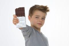 Criança feliz com seu doce Fotos de Stock