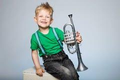 Criança feliz com trombeta fotografia de stock royalty free