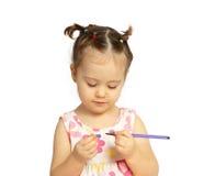 A criança feliz com um lápis e uma mão Imagens de Stock