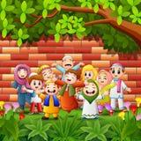 A criança feliz dos desenhos animados comemora o eid Mubarak com fundo da parede de tijolo Imagem de Stock