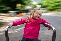 Criança feliz em um carrossel Imagem de Stock Royalty Free