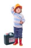 Criança feliz no capacete de segurança com ferramentas Fotografia de Stock
