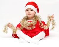 Criança feliz no chapéu de Papai Noel Fotos de Stock Royalty Free