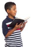 Criança feliz porque está lendo a palavra de deus Fotos de Stock Royalty Free