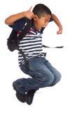Criança feliz porque se realiza de volta ao tempo da escola Fotos de Stock Royalty Free
