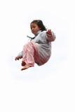 A criança feliz salta Fotos de Stock Royalty Free