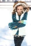 Criança fria na tempestade da neve Fotos de Stock Royalty Free