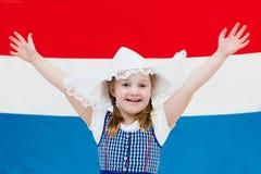 Criança holandesa com a bandeira de Países Baixos Fotografia de Stock Royalty Free