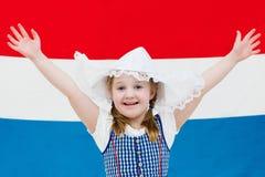 Criança holandesa com a bandeira de Países Baixos Fotos de Stock